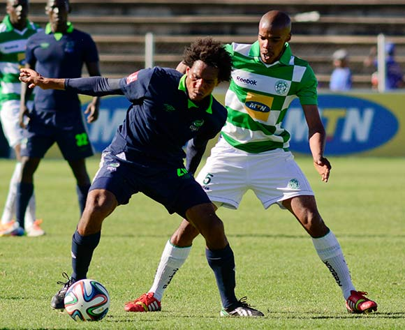 Issa Sarr of Platinum Stars and Wandisile Letlabika of Bloemfontein Celtic during the Absa Premiership match between Bloemfontein Celtic and Platinum Stars on 6 April 2014 at Kaizer Sebothelo Stadium