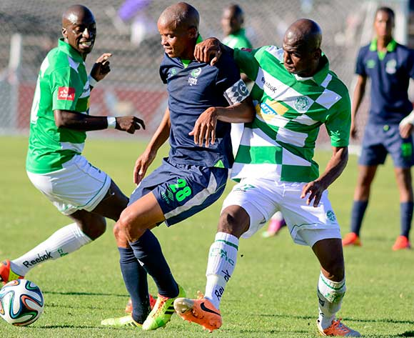 Solomon Mathe of Platinum Stars and Alfred Ndengane of Bloemfontein Celtic during the Absa Premiership match between Bloemfontein Celtic and Platinum Stars on 6 April 2014 at Kaizer Sebothelo Stadium
