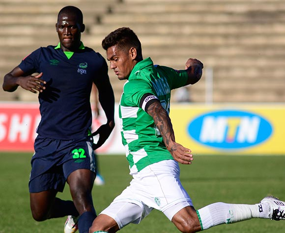 Clayton Daniels of Bloemfontein Celtic and Siphelele Mthembu of Platinum Stars during the Absa Premiership match between Bloemfontein Celtic and Platinum Stars on 6 April 2014 at Kaizer Sebothelo Stadium