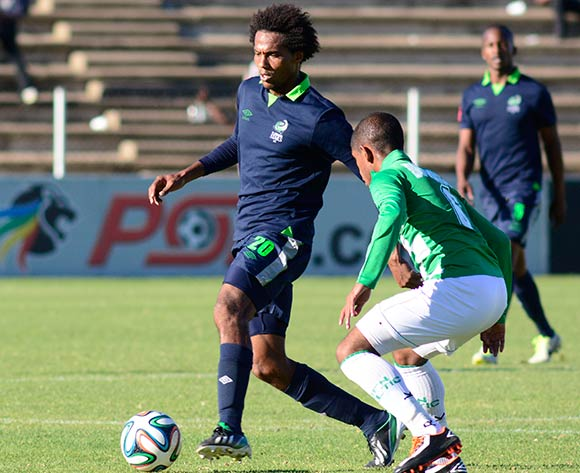 Issa Sarr of Platinum Stars and Keagan Buchanan of Bloemfontein Celtic during the Absa Premiership match between Bloemfontein Celtic and Platinum Stars on 6 April 2014 at Kaizer Sebothelo Stadium