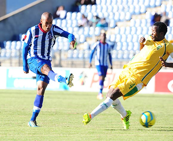 Kurt Lentjies of Maritzburg United takes a shot past Joseph Musonda of Golden Arrows during the Absa Premiership 2013/14 football match between Maritzburg United v Golden Arrows at the Harry Gwala Stadium in Pietermaritzburg , Kwa-Zulu Natal on the 6th of April 2014