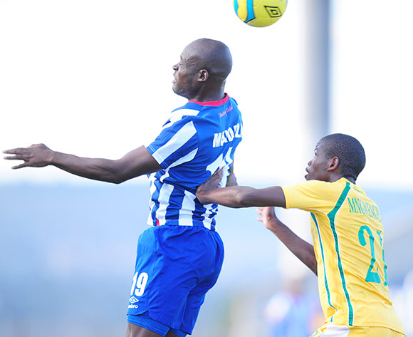 Terrence Mandaza of Maritzburg United challenged by Nkanyiso Mngwengwe of Golden Arrows during the Absa Premiership 2013/14 football match between Maritzburg United v Golden Arrows at the Harry Gwala Stadium in Pietermaritzburg , Kwa-Zulu Natal on the 6th of April 2014