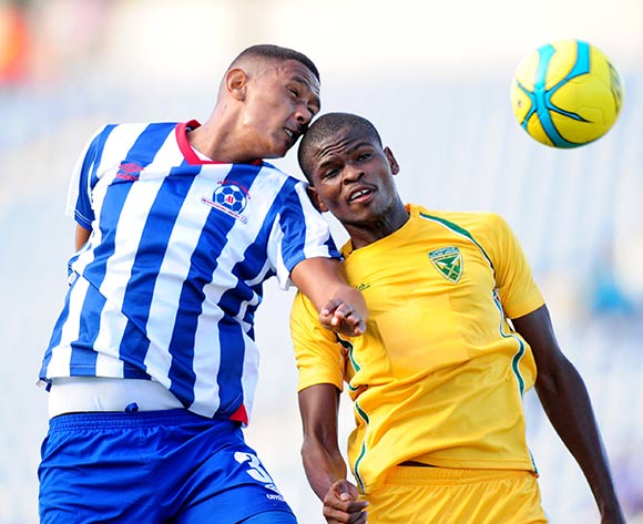 Mario Booysen of Maritzburg United challenged by Nkanyiso Mngwengwe of Golden Arrows during the Absa Premiership 2013/14 football match between Maritzburg United v Golden Arrows at the Harry Gwala Stadium in Pietermaritzburg , Kwa-Zulu Natal on the 6th of April 2014