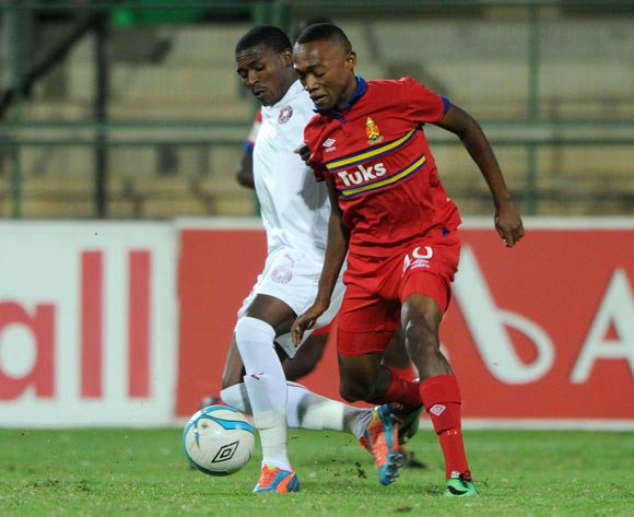 Thabo Mnyamane of University Pretoria challenged by Vuyisile Wana of Moroka Swallows during the Absa Premiership 2013/14 match between University of Pretoria v Moroka Swallows at Tuks Stadium in Pretoriaon the 08 April 2014