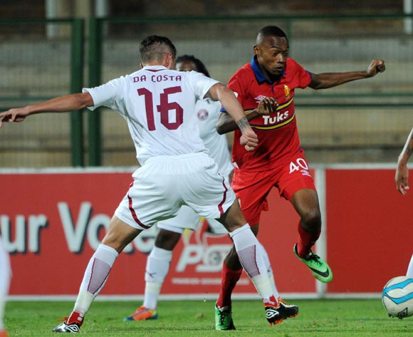Thabo Mnyamane of University Pretoria battles with Roger Da Costa of Moroka Swallows during the Absa Premiership 2013/14 match between University of Pretoria v Moroka Swallows at Tuks Stadium in Pretoriaon the 08 April 2014