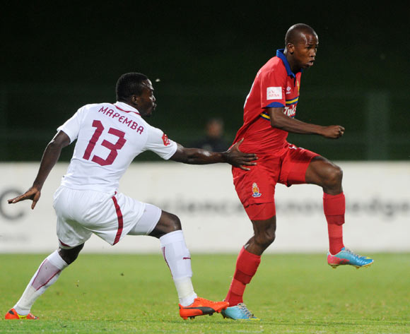 Thabo Mosadi of University Pretoria challenged by Gilbert Mapemba of Moroka Swallows during the Absa Premiership 2013/14 match between University of Pretoria v Moroka Swallows at Tuks Stadium in Pretoriaon the 08 April 2014