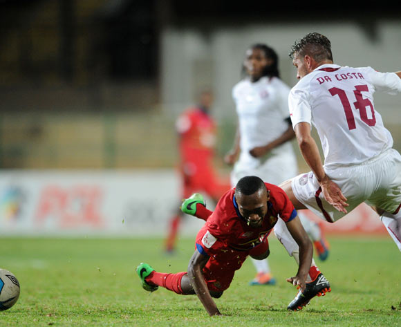 Thabo Mnyamane of University Pretoria fouled by Roger Da Costa of Moroka Swallows during the Absa Premiership 2013/14 match between University of Pretoria v Moroka Swallows at Tuks Stadium in Pretoriaon the 08 April 2014