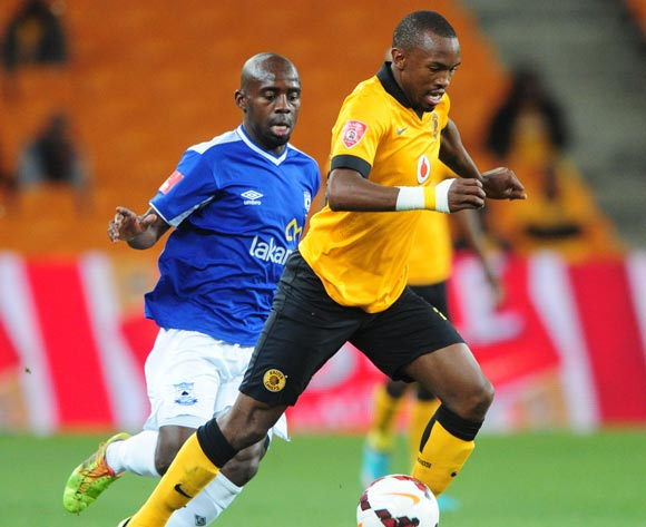 Bernard Parker of Kaizer Chiefs challenged by Sandile Zuke of Black Aces during the Absa Premiership 2013/14 match between Kaizer Chiefs and Black Aces at FNB Stadium in Johannesburg on the 09 April 2014