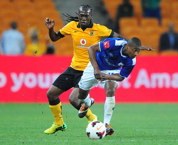 Thabo Qalinge of Black Aces battles with Reneilwe Letsholonyane of Kaizer Chiefs during the Absa Premiership 2013/14 match between Kaizer Chiefs and Black Aces at FNB Stadium in Johannesburg on the 09 April 2014
