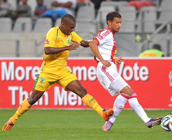 Nazeer Allie of Ajax Cape Town gets the ball back to his keeper while Bongi Ntuli of Golden Arrows challenges during the Absa Premiership 2013/14 game between Ajax Cape Town and Golden Arrows at Cape Town Stadium, Cape Town on 9 April 2014