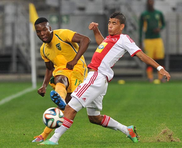 Siyanda Zwane of Golden Arrows gets his pass down the line as Keagan Dolly of Ajax Cape Town closes him down during the Absa Premiership 2013/14 game between Ajax Cape Town and Golden Arrows at Cape Town Stadium, Cape Town on 9 April 2014