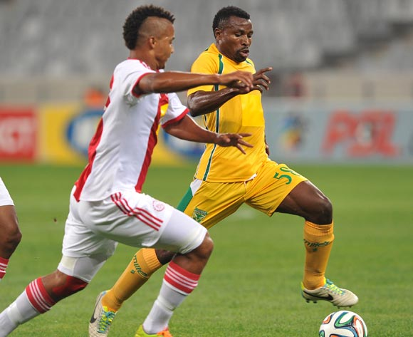 Christopher Katongo of Golden Arrows takes on Rivaldo Coetzee of Ajax Cape Town during the Absa Premiership 2013/14 game between Ajax Cape Town and Golden Arrows at Cape Town Stadium, Cape Town on 9 April 2014