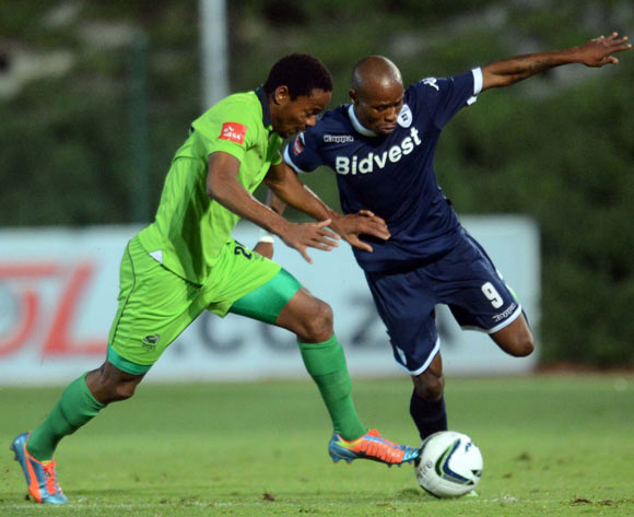 Calvin Kadi of Bidvest Wits battles with Thabiso Semenya of Platinum Stars during the Absa Premiership match between Bidvest Wits and Platinum Stars on the 09 of April 2014 at Bidvest Stadium