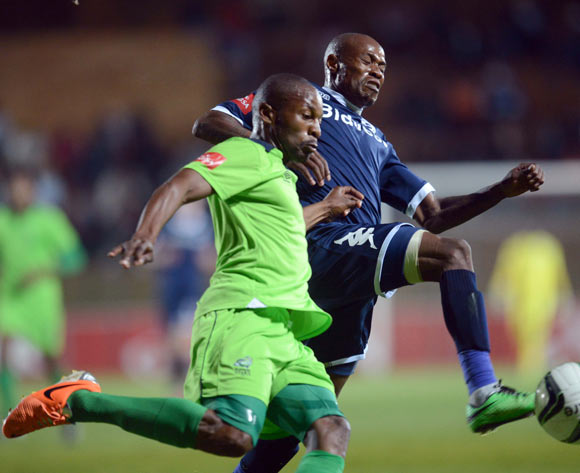 Calvin Kadi of Bidvest Wits battles with Gift Sithole of Platinum Stars during the Absa Premiership match between Bidvest Wits and Platinum Stars on the 09 of April 2014 at Bidvest Stadium
