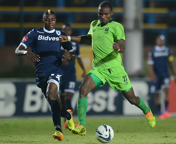 Papy Faty of Bidvest Wits battles with Robert Ngambi of Platinum Stars during the Absa Premiership match between Bidvest Wits and Platinum Stars on the 09 of April 2014 at Bidvest Stadium