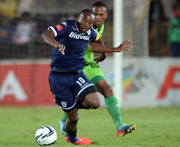 Sibusiso Vilakazi of Bidvest Wits battles with Luvolwethu Mpeta of Platinum Stars during the Absa Premiership match between Bidvest Wits and Platinum Stars on the 09 of April 2014 at Bidvest Stadium