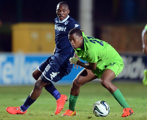 Sibusiso Vilakazi of Bidvest Wits battles with Tshepo Gumede of Platinum Stars during the Absa Premiership match between Bidvest Wits and Platinum Stars on the 09 of April 2014 at Bidvest Stadium
