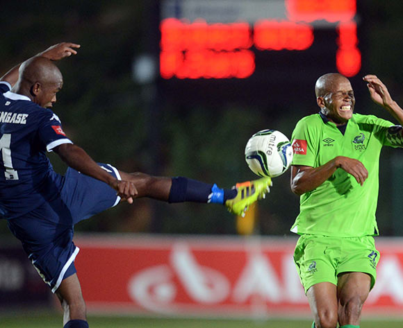 Phumlani Ntshangase of Bidvest Wits battles with Solomon Mathe of Platinum Stars during the Absa Premiership match between Bidvest Wits and Platinum Stars on the 09 of April 2014 at Bidvest Stadium