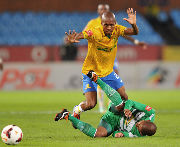 Keagan Buchanan of Bloemfontein Celtic challenged by Lebohang Mokoena of Mamelodi Sundowns during the Absa Premiership football match between Mamelodi Sundowns and Bloemfontein Celtic at the Loftus Stadium, Pretoria on o9 April 2014