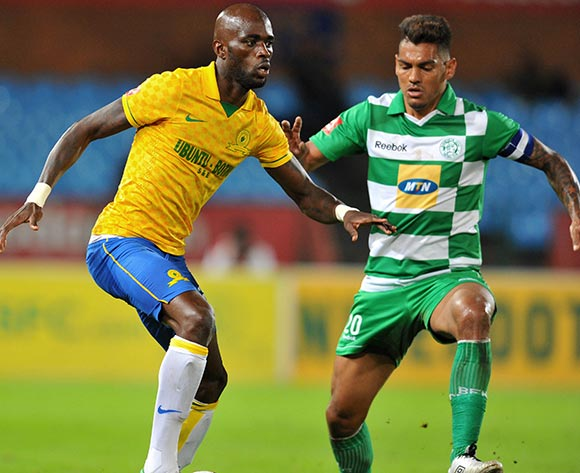 Anthony Laffor of Mamelodi Sundowns challenged by Clayton Daniels of Bloemfontein Celtic during the Absa Premiership football match between Mamelodi Sundowns and Bloemfontein Celtic at the Loftus Stadium, Pretoria on o9 April 2014