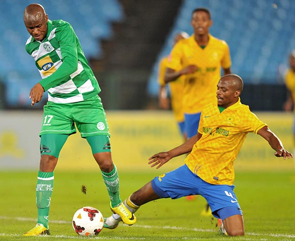 Joel Mogorosi of Bloemfontein Celtic tackled by Tebogo Langerman of Mamelodi Sundowns during the Absa Premiership football match between Mamelodi Sundowns and Bloemfontein Celtic at the Loftus Stadium, Pretoria on o9 April 2014