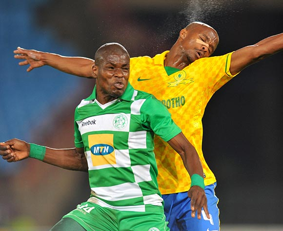 Lerato Lamola of Bloemfontein Celtic challenged by Tebogo Langerman of Mamelodi Sundowns during the Absa Premiership football match between Mamelodi Sundowns and Bloemfontein Celtic at the Loftus Stadium, Pretoria on o9 April 2014