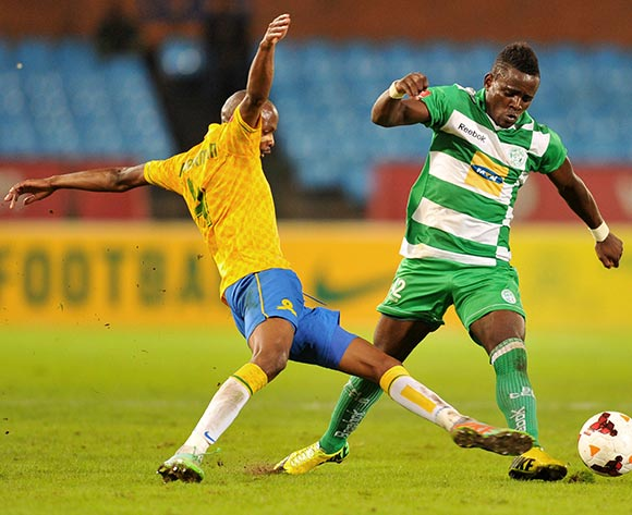 Gabadinho Mhango of Bloemfontein Celtic tackled by Tebogo Langerman of Mamelodi Sundowns during the Absa Premiership football match between Mamelodi Sundowns and Bloemfontein Celtic at the Loftus Stadium, Pretoria on o9 April 2014