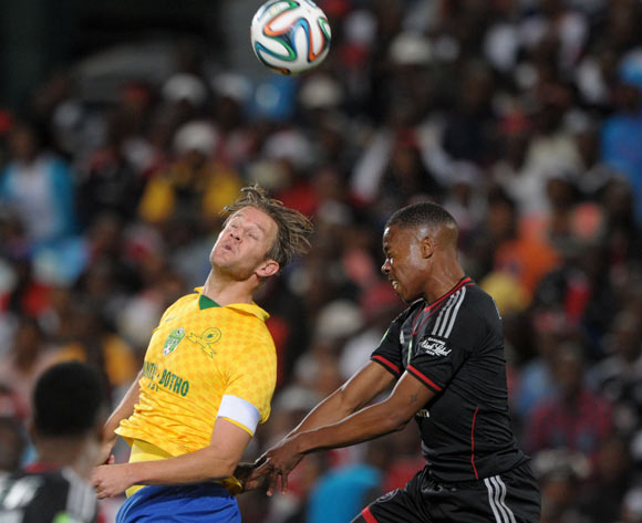 Happy Jele of Orlando Pirates battles with Alje Schut of Mamelodi Sundowns during the 2014 Nedbank Cup match between Mamelodi Sundowns and Orlando Pirates at Loftus Stadium in Pretoria on the 12 April 2014