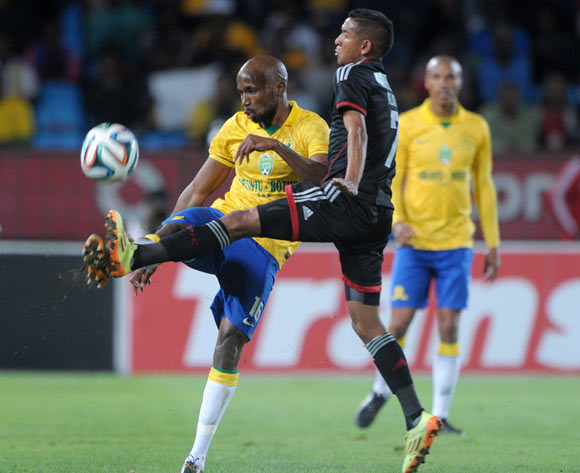 Ramahlwe Mphahlele of Mamelodi Sundowns challenged by Daine Klate of Orlando Pirates  during the 2014 Nedbank Cup match between Mamelodi Sundowns and Orlando Pirates at Loftus Stadium in Pretoria on the 12 April 2014