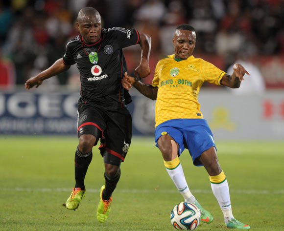 Helder Pelembe of Orlando Pirates battlles with Teko Modise of Mamelodi Sundowns during the 2014 Nedbank Cup match between Mamelodi Sundowns and Orlando Pirates at Loftus Stadium in Pretoria on the 12 April 2014