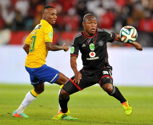 Helder Pelembe of Orlando Pirates challenged by Teko Modise of Mamelodi Sundowns during the 2014 Nedbank Cup match between Mamelodi Sundowns and Orlando Pirates on the 12 April 2014 at  Loftus Stadium