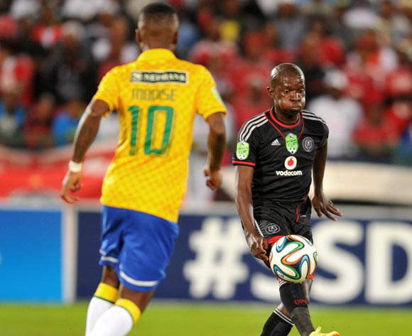 Sifiso Myeni of Orlando Pirates challenged by Teko Modise of Mamelodi Sundowns during the 2014 Nedbank Cup match between Mamelodi Sundowns and Orlando Pirates on the 12 April 2014 at  Loftus Stadium
