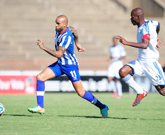 Orlando Smeekes of Maritzburg United and Ange Lebahi of African Warriors during 2014 Nedbank Cup Last 8 football match between African Warriors and Maritzburg United at the Charles Mopeli Stadium in Qwa-Qwa , Free State on the 12th of April 2014