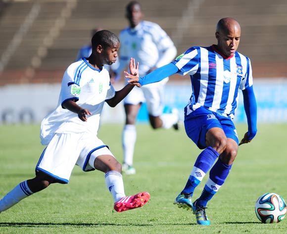 Kurt Lentjies of Maritzburg United battles Jessie Van Tonder of African Warriors during 2014 Nedbank Cup Last 8 football match between African Warriors and Maritzburg United at the Charles Mopeli Stadium in Qwa-Qwa , Free State on the 12th of April 2014