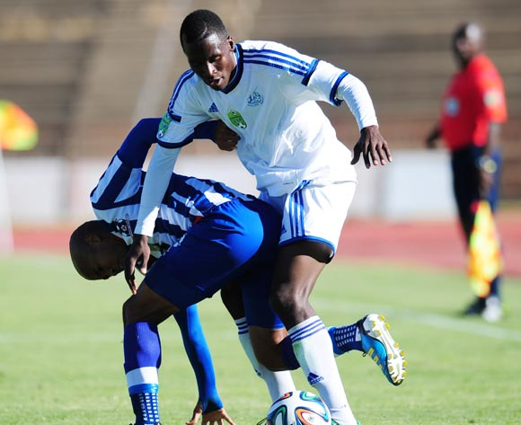 Karabo Marakane of African Warriors battles Kurt Lentjies of Maritzburg United during 2014 Nedbank Cup Last 8 football match between African Warriors and Maritzburg United at the Charles Mopeli Stadium in Qwa-Qwa , Free State on the 12th of April 2014