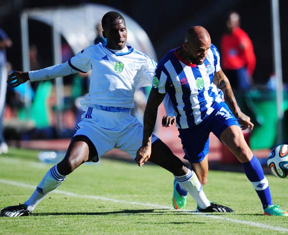 Orlando Smeekes of Maritzburg United battles Karabo Marakane of African Warriors during 2014 Nedbank Cup Last 8 football match between African Warriors and Maritzburg United at the Charles Mopeli Stadium in Qwa-Qwa , Free State on the 12th of April 2014