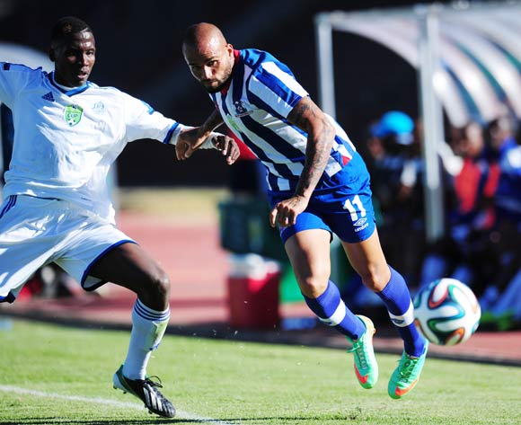 Orlando Smeekes of Maritzburg United battling Karabo Marakane of African Warriors during 2014 Nedbank Cup Last 8 football match between African Warriors and Maritzburg United at the Charles Mopeli Stadium in Qwa-Qwa , Free State on the 12th of April 2014