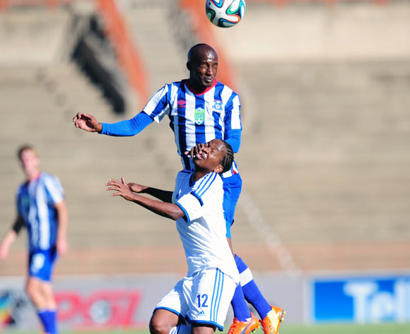 Bongolethu Jayiya of Maritzburg United battles Lynch Pule of African Warriors during 2014 Nedbank Cup Last 8 football match between African Warriors and Maritzburg United at the Charles Mopeli Stadium in Qwa-Qwa , Free State on the 12th of April 2014
