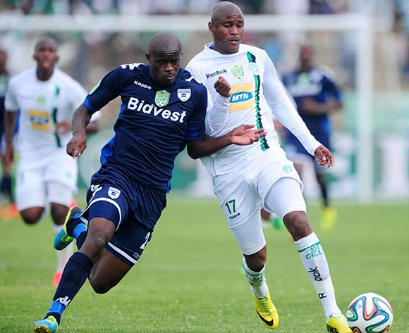 Joel Mogorosi of Bloemfontein Celtic battles with Kwanda Mngonyama of Bidvest Wits during the 2014 Nedbank Cup match between Bloemfontein Celtic and Bidvest Wits at Kaizer Sebothelo Stadium in Botshabelo on the 13 April 2014