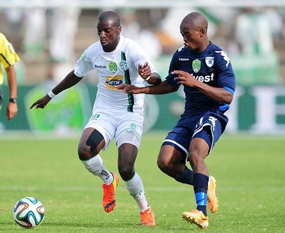 Musa Nyatama of Bloemfontein Celtic challenged by Phumlani Ntshangase of Bidvest Wits during the 2014 Nedbank Cup match between Bloemfontein Celtic and Bidvest Wits at Kaizer Sebothelo Stadium in Botshabelo on the 13 April 2014