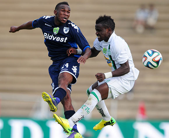 Onismor Bhasera of Bidvest Wits battles with Gabadinho Mhango of Bloemfontein Celtic during the 2014 Nedbank Cup match between Bloemfontein Celtic and Bidvest Wits at Kaizer Sebothelo Stadium in Botshabelo on the 13 April 2014