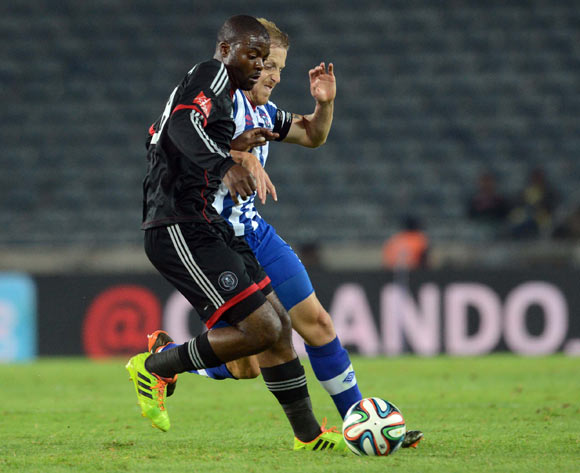 Rooi Mahamutsa of Orlando Pirates battles with Michael Morton of Maritzburg United during the Absa Premiership match between Orlando Pirates and Maritzburg United on the 15 of April 2014 at Orlando Stadium
