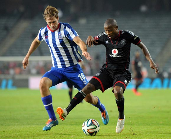 Thabo Matlaba of Orlando Pirates battles with Rheece Evans of Maritzburg United  during the Absa Premiership match between Orlando Pirates and Maritzburg United on the 15 of April 2014 at Orlando Stadium