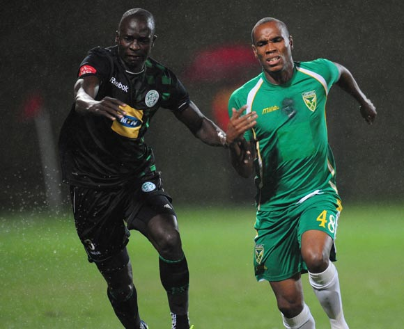 Rudolf Bester of Golden Arrows battles Lerato Lamola  of Bloemfontein Celtic during the Absa Premiership 2013/14 football match between Golden Arrows and Bloemfontein Celtic at the King Zwelithini Stadium in Durban , Kwa-Zulu Natal on the 16th of April 2014