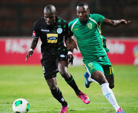 Lerato Lamola of Bloemfontein Celtic battles Siyanda Zwane of Golden Arrows during the Absa Premiership 2013/14 football match between Golden Arrows and Bloemfontein Celtic at the King Zwelithini Stadium in Durban , Kwa-Zulu Natal on the 16th of April 2014