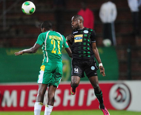 Nkanyiso Mngwengwe of Golden Arrows and Lerato Lamola of Bloemfontein Celtic during the Absa Premiership 2013/14 football match between Golden Arrows and Bloemfontein Celtic at the King Zwelithini Stadium in Durban , Kwa-Zulu Natal on the 16th of April 2014