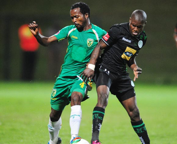 Lerato Lamola of Bloemfontein Celtic battles Joseph Musonda of Golden Arrows during the Absa Premiership 2013/14 football match between Golden Arrows and Bloemfontein Celtic at the King Zwelithini Stadium in Durban , Kwa-Zulu Natal on the 16th of April 2014