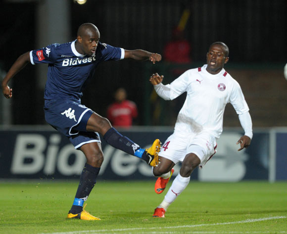Kwanda Mngonyama of Bidvest Wits clears the ball from Felix Obada of Moroka Swallows during the Absa Premiership 2013/14 match between Bidvest Wits and Moroka Swallows at Bidvest Stadium in Johannesburg on the 16 April 2014