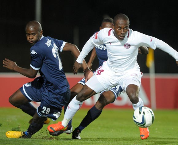 Felix Obada of Moroka Swallows challenged by Kwanda Mngonyama of Bidvest Wits during the Absa Premiership 2013/14 match between Bidvest Wits and Moroka Swallows at Bidvest Stadium in Johannesburg on the 16 April 2014