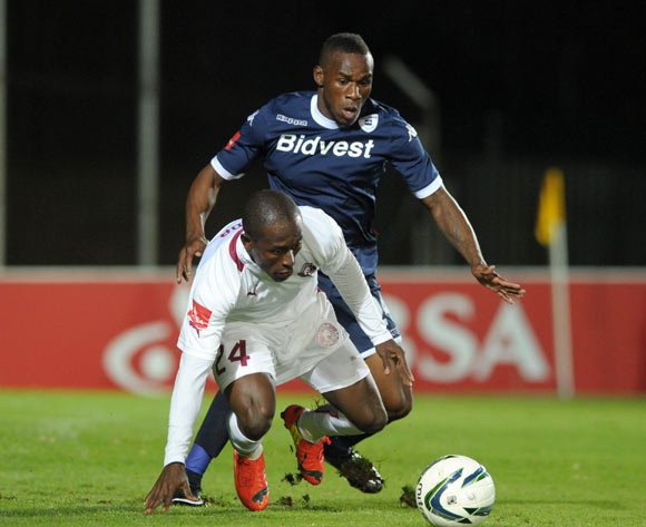 Felix Obada of Moroka Swallows challenged by Onismor Bhasera of Bidvest Wits during the Absa Premiership 2013/14 match between Bidvest Wits and Moroka Swallows at Bidvest Stadium in Johannesburg on the 16 April 2014